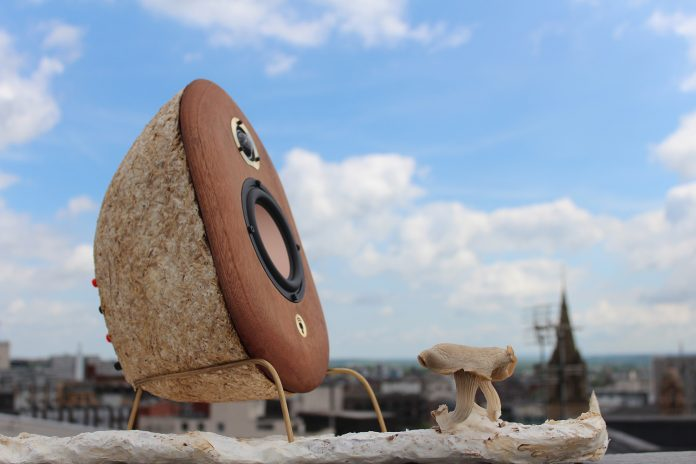 Mycelium speakers with a cityscape in the background